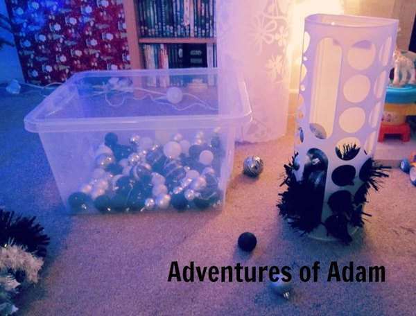 Adventures of Adam toddler play Christmas baubles dunking