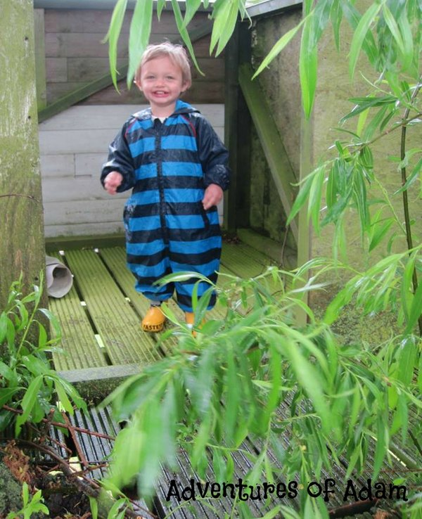 Adventures of Adam playing in the rain up the treehouse
