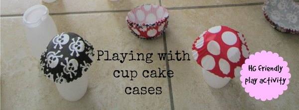 Adventures of Adam playing with cup cake cases