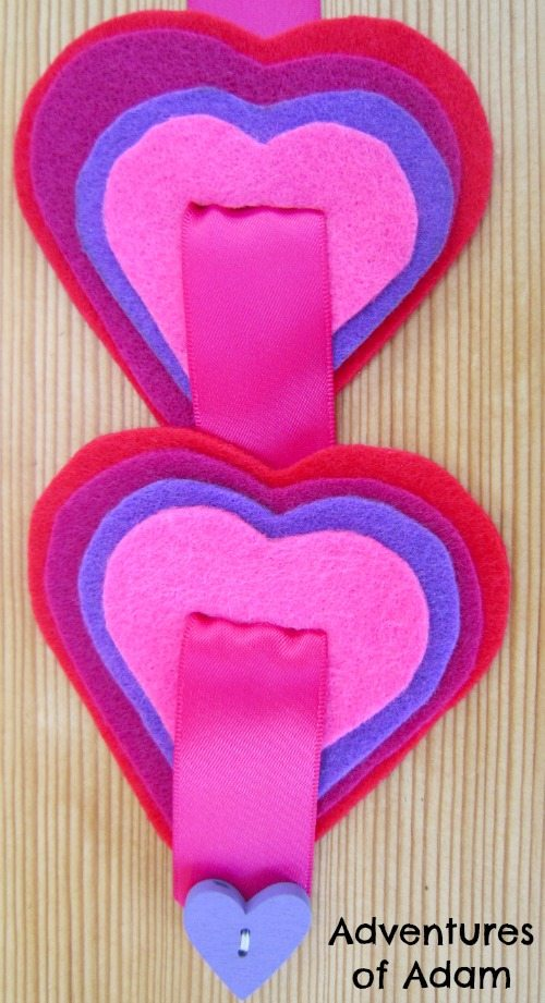 Adventures of Adam Threading felt hearts