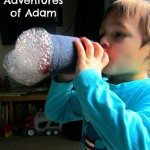 Adventures of Adam Toddler blowing bubbles