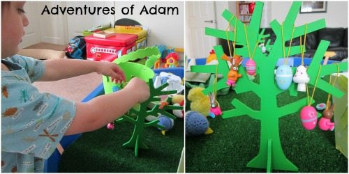 Adventures of Adam Decorating an Easter tree