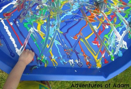Adventures of Adam Toddler making zig zags in paint