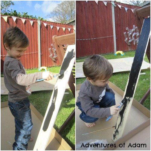 Adventures of Adam Toddler painting wood
