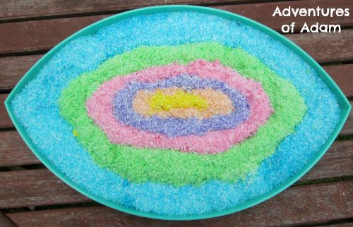 Adventures of Adam Coloured coconut sensory bin