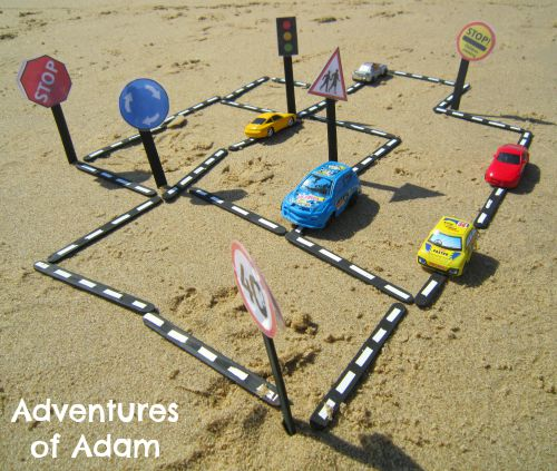 Adventures of Adam Make a car road at the beach