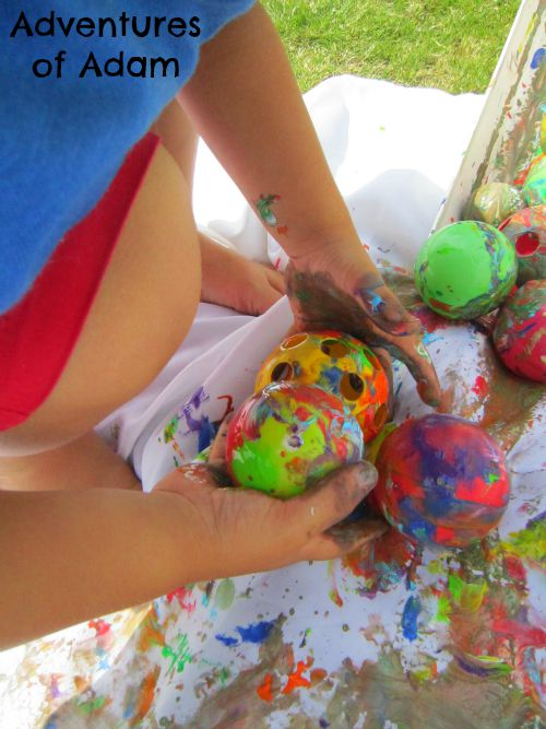 Adventures of Adam Toddler painting with balls
