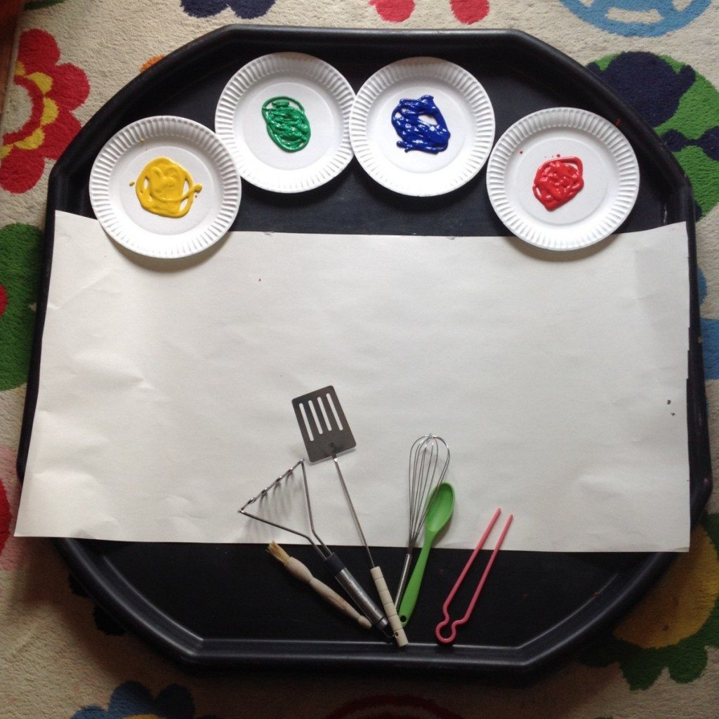 Clares Little Tots painting with kitchen utensils