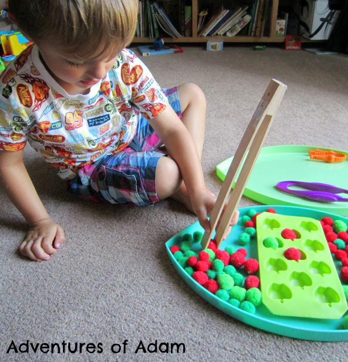 Adventures of Adam Using wooden tongs in play