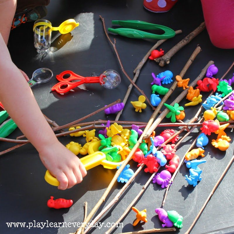 bugs in the play tray - scooping up bugs