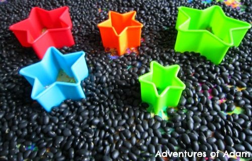 Adventures of Adam Firework and stars sensory bin