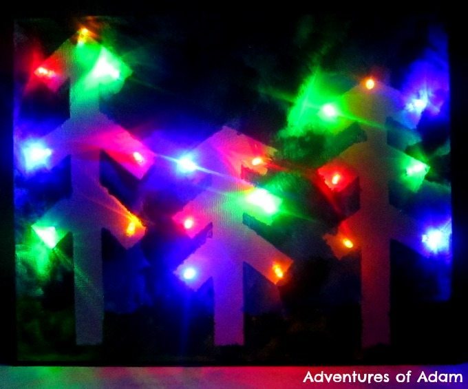 Adventures of Adam Toddler made Christmas light up canvas using fairy lights
