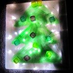 Decorate a Christmas tree on a lightbox