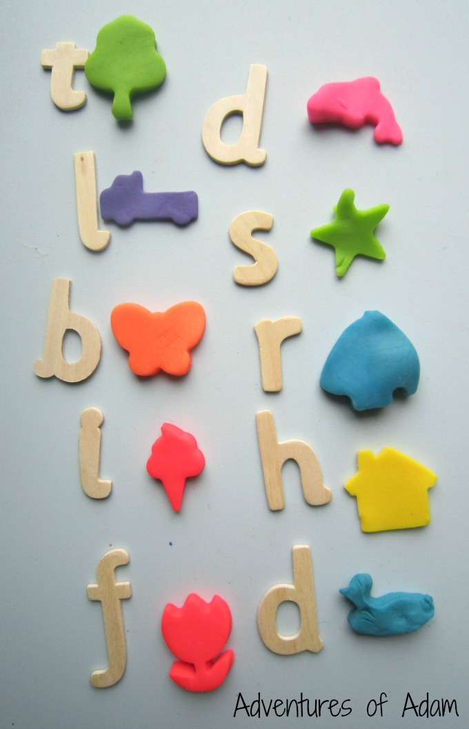Naming initial sounds with play dough cutters for Playdough letter cutters