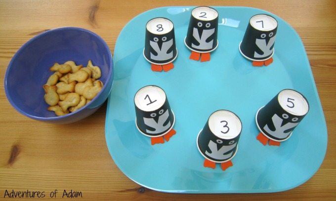 Feed the penguins fish shaped snacks