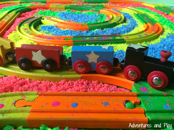 Neon rice train track sensory play