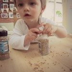 Adventures of Adam playing with spice containers