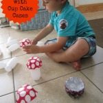 Adventures of Adam toddler playing with cup cake cases
